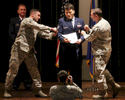 "Third Place | General NewsAndrew Craft, The Fayetteville ObserverSSgt Ronald Brown Jr. winces as he is ""tacked on"" during a promotion ceremony at Seymour Johnson Air Force Base."