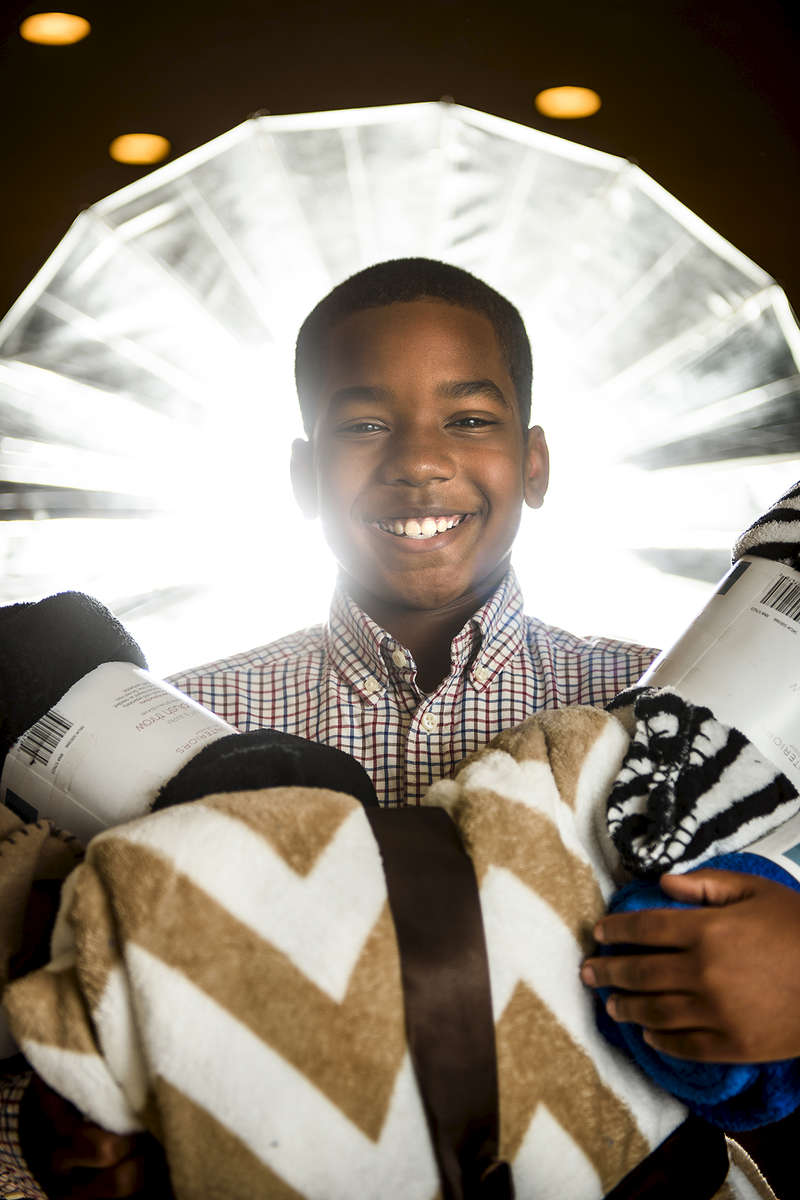Honorable Mention I PortraitAndrew Craft, The Fayetteville ObserverJosiah Boyd, 11, was inspired to begin a homeless ministry after seeing a homeless family sleeping outside of Walmart last fall. He decided he wanted to be part of the solution and began collecting blankets for area homeless families, and his efforts won him a countywide citizenship award from the school system in January. The 71st Classical Middle School student is working on his Second Annual Josiah's Blanket Ministry collection now as winter approaches.
