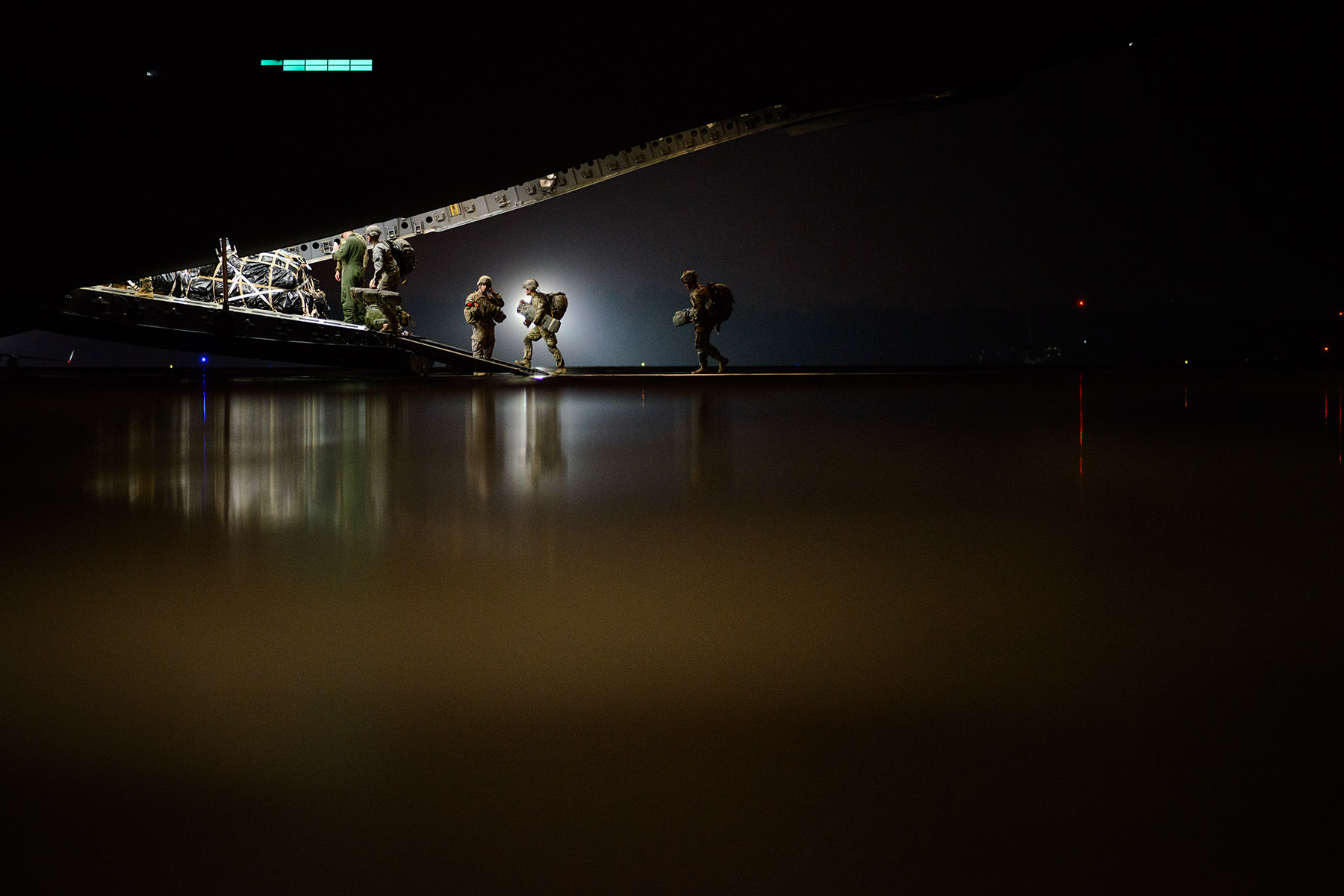 First Place | Multiple PhotosAndrew Craft, The Fayetteville Observer2nd Brigade Combat Team paratroopers board a C-17 headed for Zaragoza, Spain, Tuesday, Nov. 3, 2015, where they will jump in as part of Operation Trident Juncture 15. In support of Operations Trident Juncture 15 and Ultimate Reach 16, over 500 Paratroopers from the Division's 2nd Brigade Combat Team deployed from Pope Army Airfield, conducted in-flight rigging and executed a Joint Forcible Entry exercise in Zaragoza, Spain.