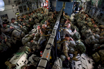 First Place | Multiple PhotosAndrew Craft, The Fayetteville ObserverParatroopers, with the 2nd Brigade Combat Team, sit in a C-17 all rigged up and ready to jump into Zaragoza, Spain, Wednesday, Nov. 4, 2015, as part of Operation Trident Juncture 15. In support of Operations Trident Juncture 15 and Ultimate Reach 16, over 500 Paratroopers from the Division's 2nd Brigade Combat Team deployed from Pope Army Airfield, conducted in-flight rigging and executed a Joint Forcible Entry exercise in Zaragoza, Spain.