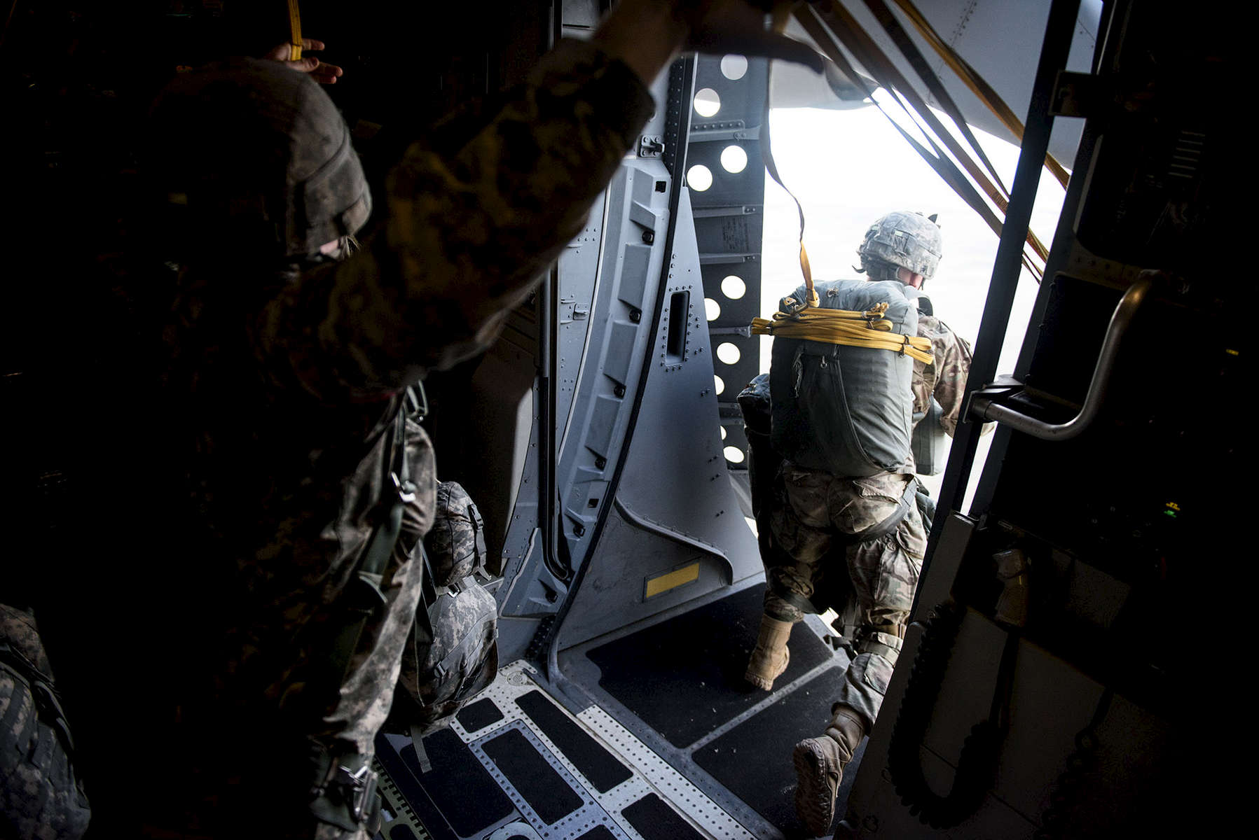 First Place | Multiple PhotosAndrew Craft, The Fayetteville ObserverParatroopers with the 2nd Brigade Combat Team, exits the door on a C-17 as the paratroopers jump into Zaragoza, Spain, Wednesday, Nov. 4, 2015, as part of Operation Trident Juncture 15. In support of Operations Trident Juncture 15 and Ultimate Reach 16, over 500 Paratroopers from the Division's 2nd Brigade Combat Team deployed from Pope Army Airfield, conducted in-flight rigging and executed a Joint Forcible Entry exercise in Zaragoza, Spain.
