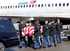 Third Place | Multiple PhotosMark Dolejs, Daily DispatchMembers of the North Carolina National Guard Honor Guard move the casket for Charles Ivey to an awaiting hearse at Raleigh-Durham International Airport on Tuesday.