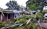 Second Place | Spot NewsMykal McEldowney, The Greenville NewsScott White, neighbor and good samaritan with a chainsaw, helps remove a large fallen tree from the home of Taylors resident Anne Smith on Oct. 4, 2015. Smith says she has lived in the home for 55 years.