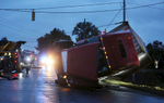 Honorable Mention I Spot NewsCasey Mozingo, The Free PressA crew uses four tow trucks to straighten an 18-wheeler that flipped onto its' side following an accident Tuesday morning at the intersection of US Highway 117 and Arrington Bridge Road.