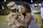 Honorable Mention I General NewsMykal McEldowney, The Greenville NewsWade Hampton senior Peterra McCarroll is surprised by her father, U.S. Army Sergeant Hiram McCarroll, who has been deployed in Kuwait on his fourth tour of duty, during halftime homecoming festivities on Oct. 9, 2015.