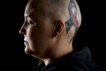Third Place | PortraitAndrew Craft, The Fayetteville Observer38-year-old nurse Carolyn Lugo was diagnosed with breast cancer this past summer. Her husband Damien, who owns a tattoo shop, recently tattooed a large pink ribbon on Carolyn's head.