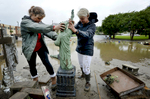 Third Place | Multiple PhotosMykal McEldowney, The Greenville NewsFrom left, Collins McDougall, sister of Forest Lake Gardens owner Joseph McDougall, and Sandy Roberts, a customer of the store help pick up a decorative cement yard statue after a massive flood on Oct. 5, 2015.