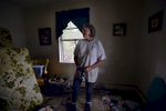 Third Place | Multiple PhotosMykal McEldowney, The Greenville NewsCheryl Stevenson, a homeowner in the Forest Acres area of Columbia, stands in her flood-soaked bedroom on Oct. 5, 2015. Along with family members, Stevenson worked to remove everything she could that was salvageable.