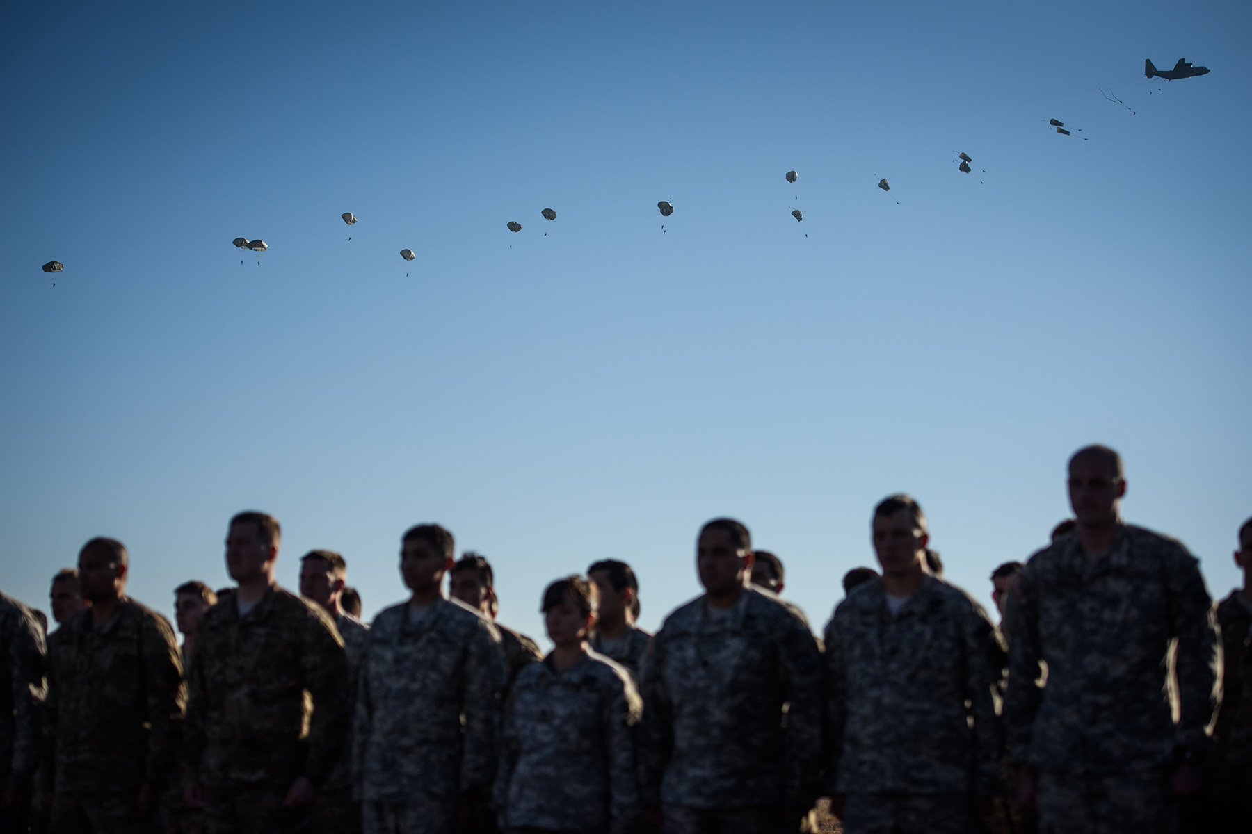 Third Place | General NewsAndrew Craft, The Fayetteville ObserverParatroopers wait to get pinned with Dutch jump wings as their fellow paratroopers float to the ground after making a jump from a C-130 Saturday, Dec. 5, 2015, during the 18th annual Randy Oler Memorial Operation Toy Drop at Sicily Drop Zone.