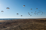 First Place | Multiple PhotosTimothy Hale, FreelanceU.S. Army paratroopers fill the sky at Sicily Drop Zone for the 18th Annual Randy Oler Memorial Operation Toy Drop, hosted by U.S. Army Civil Affairs & Psychological Operations Command (Airborne), Dec. 5, 2015 at Fort Bragg, N.C. Operation Toy Drop is the world's largest combined airborne operation and allows Soldiers the opportunity to help children in need everywhere receive toys for the holidays.