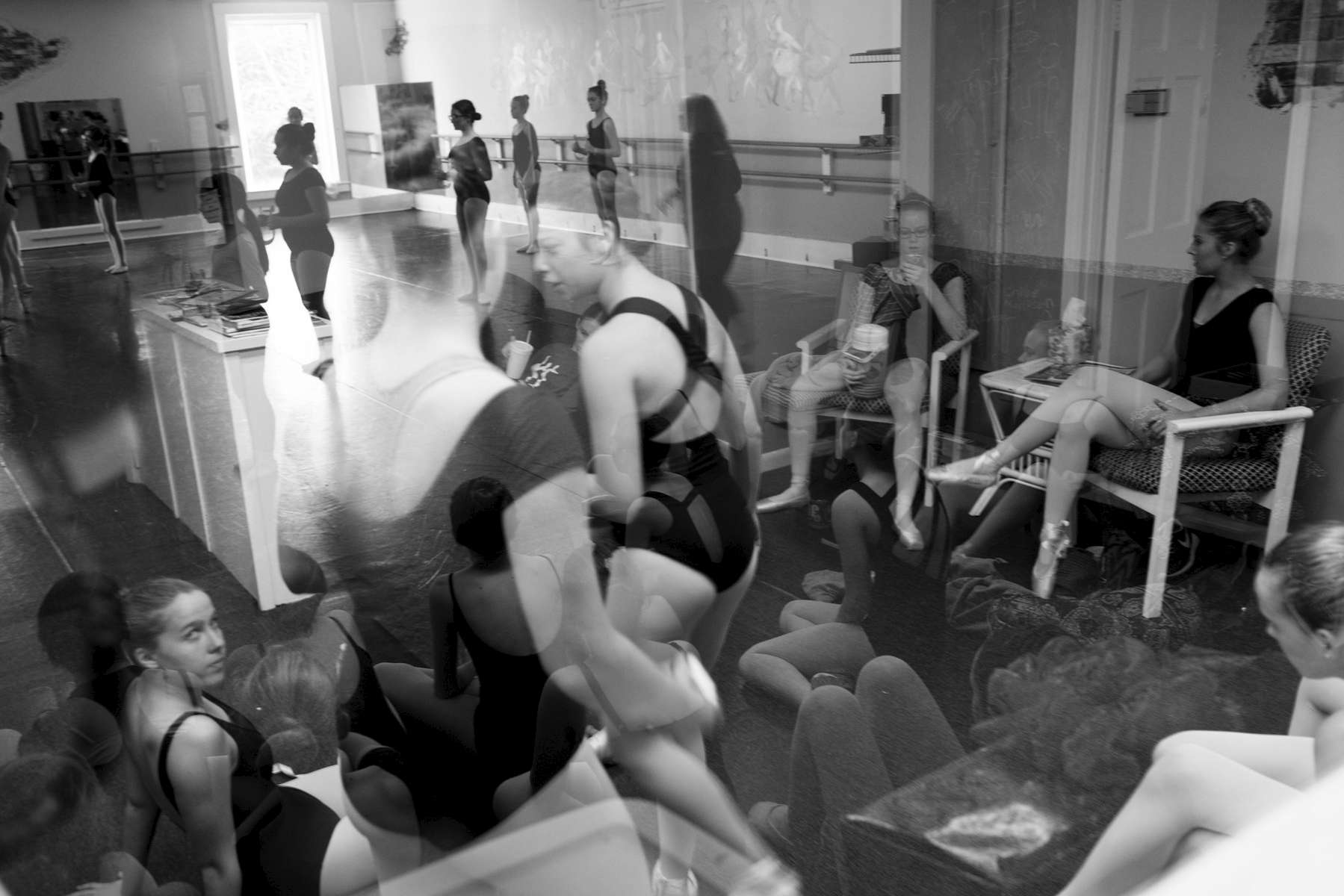 Second Place | Multiple PhotosSara Corce, The PilotIn the middle of a fifteen-minute-break, a group of dancers are seen reflected in a viewing window as others continue with their numbers in the studio during rehearsal for the 2015 production of The Nutcracker at the Terpsichore Dance studio on Saturday, December 12, 2015 in Southern Pines, North Carolina.