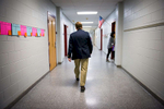 Third Place | Multiple PhotosSara Corce, The PilotMoore County School Superintendent Bob Grimesey walks the first grade hall at Vass-Lakeview Elementary School as on Tuesday, November 24, 2015 in Vass, North Carolina.