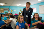 Third Place | Multiple PhotosSara Corce, The PilotMoore County School Superintendent Bob Grimesey pauses to look over the math problem while working with his teammates while spending time with students of the fifth-grade-class at Vass-Lakeview Elementary School on Tuesday, November 24, 2015 l in Vass, North Carolina.