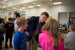 Third Place | Multiple PhotosSara Corce, The PilotMoore County School Superintendent Bob Grimesey speaks with students while standing in the lunch line of the cafeteria as he spends time with students on Tuesday, November 24, 2015 at Vass-Lakeview Elementary School in Vass, North Carolina.
