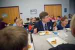 Third Place | Multiple PhotosSara Corce, The PilotMoore County School Superintendent Bob Grimesey spends time with students, eating another school-lunch with students, in the cafeteria on Tuesday, November 24, 2015 at Vass-Lakeview Elementary School in Vass, North Carolina.