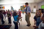 Third Place | Multiple PhotosSara Corce, The PilotMoore County School Superintendent Bob Grimesey dances with members of a kindergarten music class to the {quote}What does the Fox Say{quote} song  as he spends time with students on Tuesday, November 24, 2015 at Vass-Lakeview Elementary School in Vass, North Carolina.