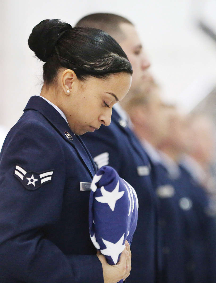 Third Place | General NewsCasey Mozingo, The Free PressAn airman bows her head during the flag ceremony during the retirement of CMSgt. Jeffrey Craver, 4th Fighter Wing command fhief, at Seymour Johnson Air Force Base. Craver retired after 30 years of service in the Air Force.