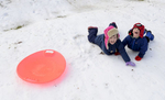 Second Place | FeatureJohn D. Simmons, The Charlotte ObserverMolly Hadlow, 6, and her two-year-old brother Patrick Hadlow squeal with delight after they tumbled from their snow disc at Latta Park. Folks flocked to hillsides for some sledding across the Charlotte region including more than 100 at Latta Park on Saturday, Jan. 23, 2016.