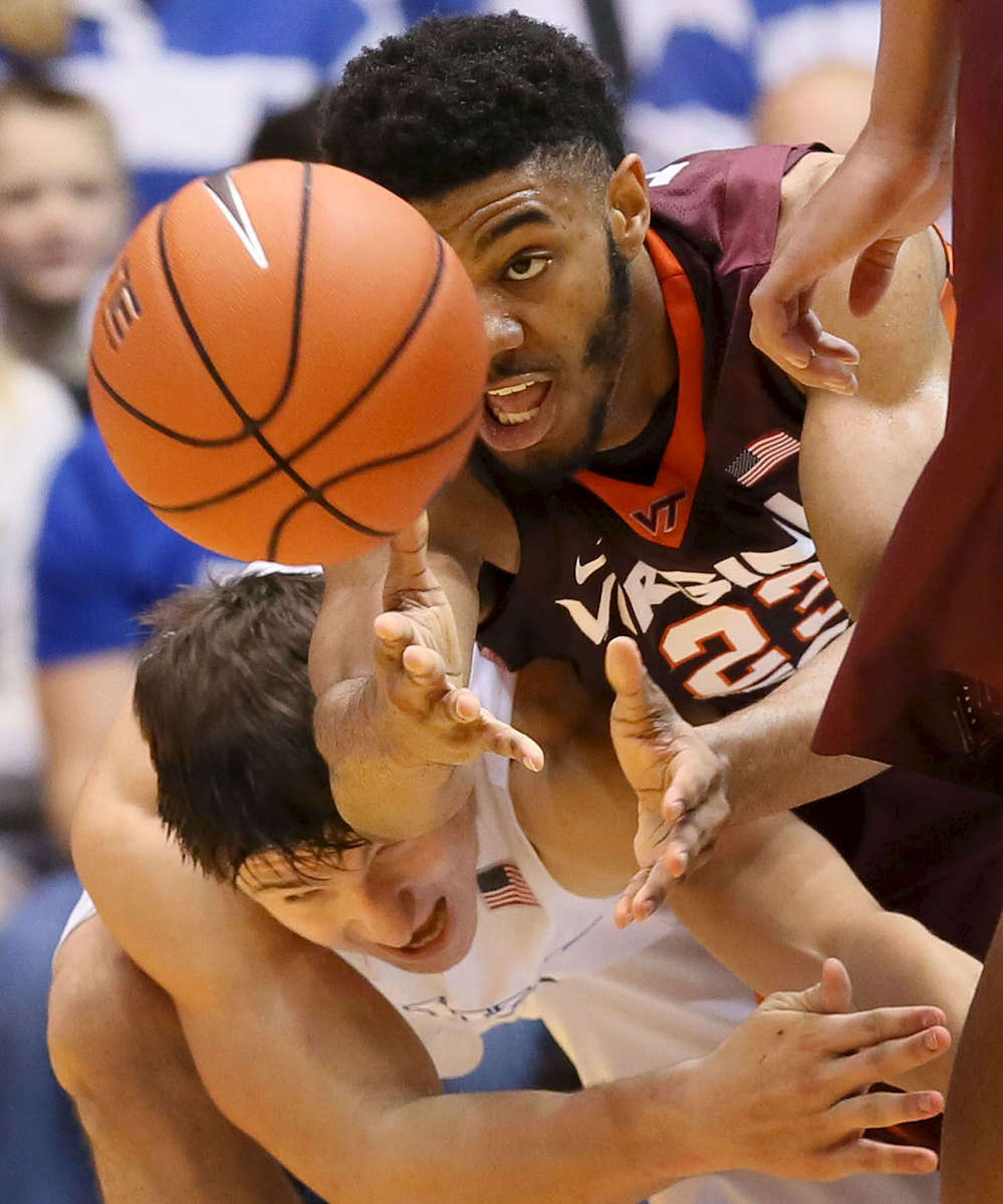 First Place | SportsMark Dolejs, Daily DispatchVirginia Tech's Jalen Hudson (23) goes over Duke's Grayson Allen (3) as he reaches for the ball in their game at Cameron Indoor Stadium