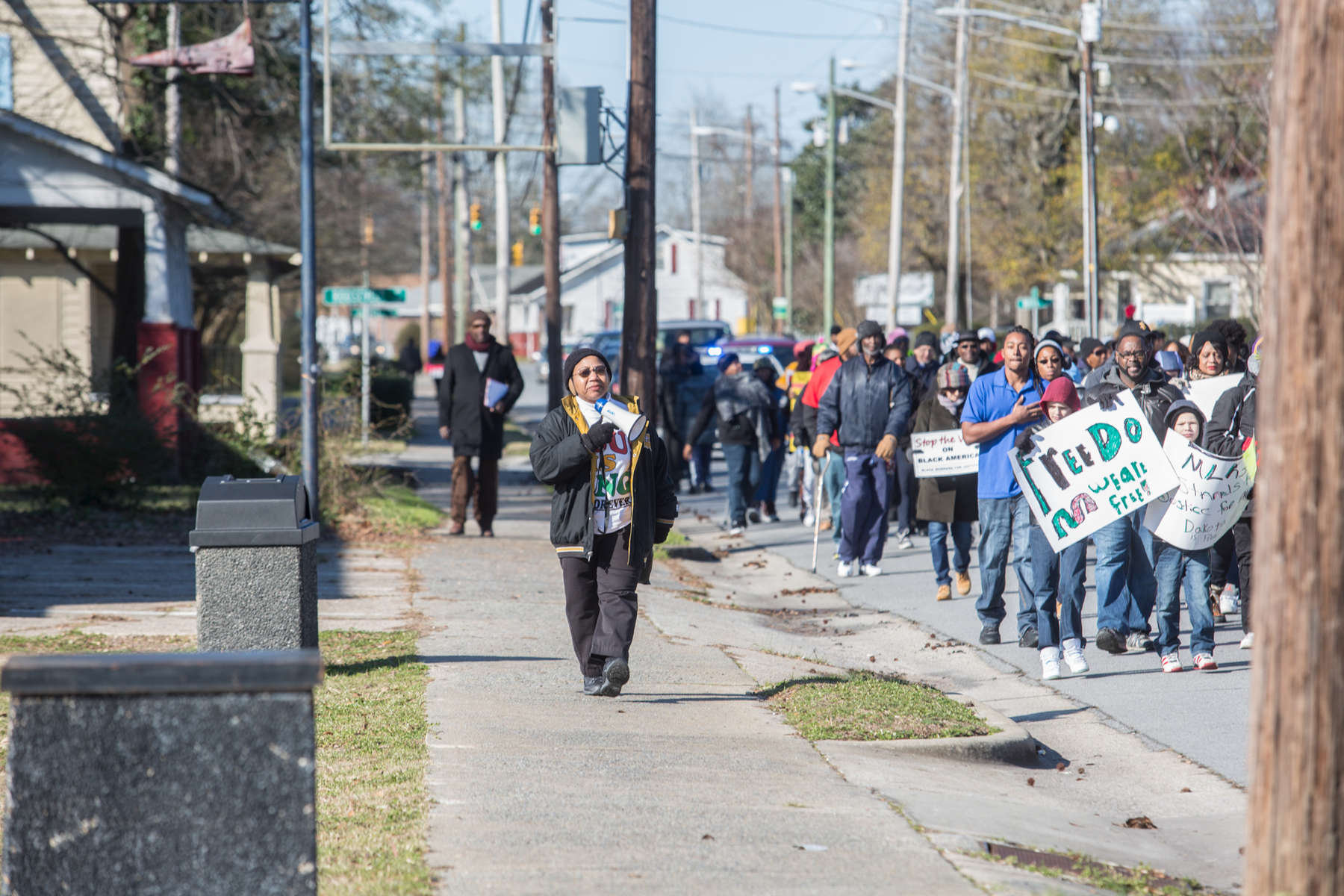 First Place | Multiple PhotosJoe Pellegrino, The Daily ReflectorDemonstrators march up West 5th street as part of the Martin Luther King Day march and rally on Jan. 18, 2016.