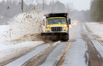 Second Place | Multiple PhotosMark Dolejs, Daily DispatchA North Carolina Department of Transportation truck removes snow along N.C. 39 North on Saturday afternoon.