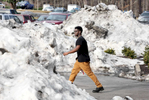 Second Place | Multiple PhotosMark Dolejs, Daily DispatchAmongst mountains of snow, plowed from the parking lots, Vance County Early College student Darius Williams walks to his car after getting out of school Wednesday afternoon. Students returned to campus for the first time since Thursday of last week.
