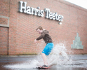 Honorable Mention I FeatureJoe Pellegrino, The Daily ReflectorCorey Frances surfs in a puddle near Harris Teeter on 14th street after a rainstorm on Feb. 24, 2016.