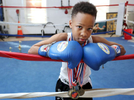 Honorable Mention I PortraitCasey Mozingo, The Free PressShy'heim Ashford, 10, stands in the boxing ring of his father's gym decorated with the medals he has earned in various boxing competitions. Ashford's Boxing Club offers children of the city a place to go to train, learn and develop discipline.