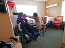 First Place | Multiple PhotosKen Ruinard, Anderson Independent MailDee Loner (left), of Honea Path, is checked on by her husband Rev. Gregg Loner at Brookdale Senior Living Solutions in Greenville. Dee, who suffered a brain aneurysm August 20, 2015 before getting to start the new school year with 4K children at Honea Path Elementary School in Anderson School District 2, is going through occupational, physical, and speech therapy as her rehab. Family and friends from Princeton Baptist Church, his former church River Street Baptist, and others churches have helped support the cost of treatments.