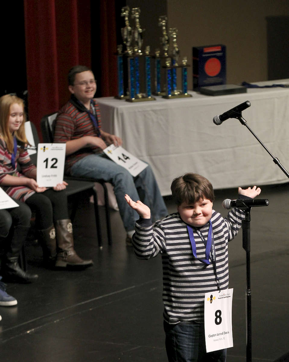Second Place | FeatureKen Ruinard, Anderson Independent MailClayton Jarred Davis, a fourth grade student from Honea Path Elementary in Honea Path, reacts during the first round during the Independent Mail Regional Spelling Bee Saturday in the Henderson Auditorium at Anderson University.