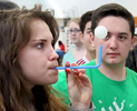 Honorable Mention I FeatureMark Dolejs, Daily DispatchJared Kindlespire (right) watches as Kendall Harris makes an attempt to balance a ping pong ball by blowing through a straw. The Southern Vance students were learning about how planes are able to stay in the air at the North Carolina Science Festival booth as part of the resource fair held Thursday.