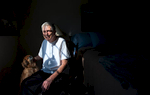 Third Place | PortraitKaitlin McKeown, Durham Herald SunJack Bankston, 69, sits with his Pekingese, Casey, in the afternoon light at his Durham apartment. Bankston, who has Chronic Obstructive Pulmonary Disease and congestive heart failure, has been in Hospice care for four months. Due to his financial situation, he may be forced to leave his home after living 14 years at the apartment complex.