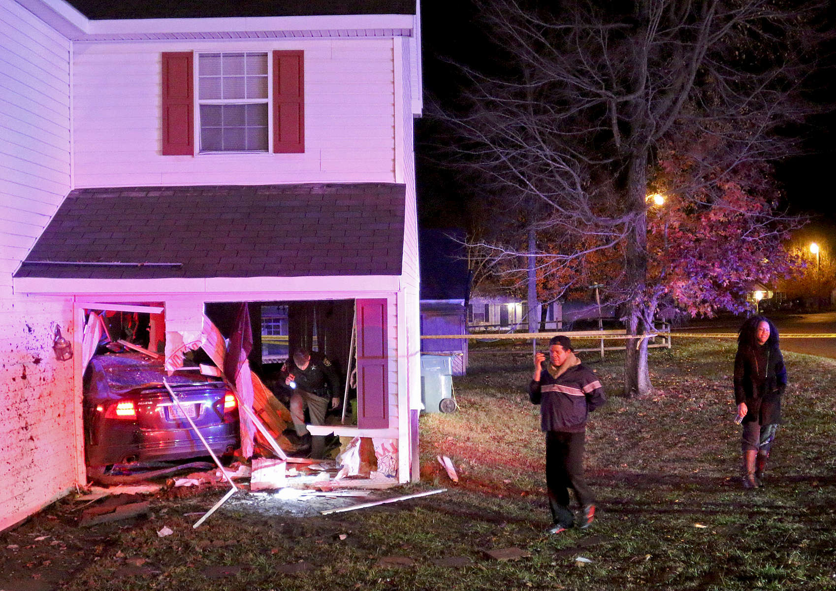 Third Place | Spot News Julian Harrison, FreelanceCarlos and Maria Rosas were asleep in their second floor bedroom when a car being chased by deputies ran off the road and crashed into their home. The driver jumped and ran leaving his girlfriend and a small baby behind.