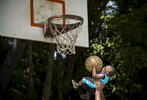 Honorable Mention | Feature Dillon Deaton, UNC Chapel Hill18 month-old Zyhier Gregory is lifted up by his uncle Derrick Conor to shoot a basket while playing basketball with his family in Freedom Park in Charlotte, N.C. on Saturday, June 13, 2015. Zyhier's father Darius Gregory says that Zyhier is learning to play basketball on his Fisher-Price basketball goal at home.