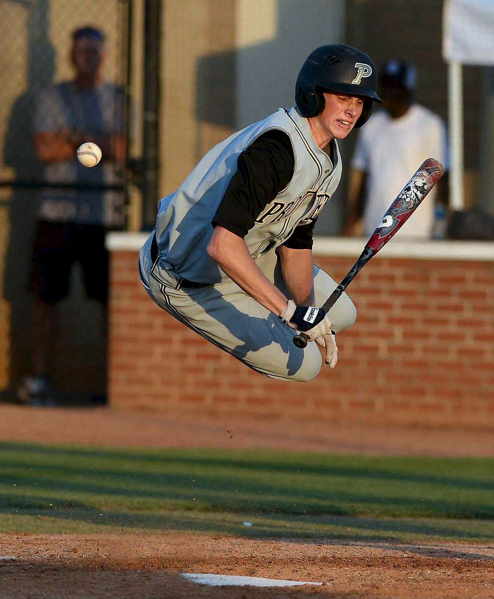 Third Place | Sports Robert  Lahser, Charlotte Observer Providence high's batter Logan Davidson gets hit with the pitch during Tuesday's game played at Ardrey Kell high school April 21,2015.