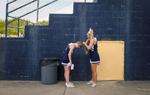 Third Place | Sports Feature Andrew Dye, Winston-Salem JournalEast Forsyth senior cheerleader Erica Smith helps fellow senior Marlee Young fix her hair prior to the football game against Mount Tabor.
