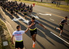 Honorable Mention | Sports Feature Andrew Craft, The Fayetteville ObserverMaj. Gen. Richard D. Clarke, left, high fives an 82nd Airborne Division paratrooper during the division run Monday, May 18, 2015, on Fort Bragg, N.C.
