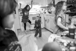 First Place | News Photo Story Dillon Deaton, UNC Chapel HillJazz, 8, Dominique, 2, and Katana, 8, left to right, dance around in the kitchen while Arielle tried to unwind after getting home from work.