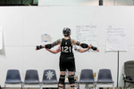 First Place | Sports Photo Story Anna Spelman, University of North CarolinaOne of CRG's captains, {quote}Q{quote}, (her roller derby name) stretches with another player at practice on September 6, 2015. {quote}Q{quote} and {quote}Princess America{quote} (roller derby name) have been on the team the longest. {quote}People say that there are 'new' people on the team{quote}, says {quote}Q{quote}. {quote}To me and Princess, everyone is new!{quote}