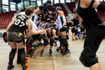 First Place | Sports Photo Story Anna Spelman, University of North Carolina{quote}Mako Gory{quote} (roller derby name), of the Carolina Rollergirls, comes through the opposing team's pyramid after a game to shake hands. Most roller derby teams are very friendly with each other, even though they compete.