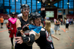 First Place | Sports Photo Story Anna Spelman, University of North Carolina{quote}Q{quote} gives the MVP scarf to her teammate {quote}Ginger Clobbers{quote} (roller derby names) on September 12, 2015. Ginger was nominated by the opposing team, Carolina Collision, one of the few all-male roller derby teams.