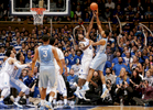 Second Place | Sports Photo StoryMark Dolejs, The Daily DispatchNorth Carolina's Isaiah Hicks (22) shoots against Duke's Amile Jefferson (21) in their game at Cameron Indoor Stadium.