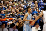 Second Place | Sports Photo StoryMark Dolejs, The Daily DispatchNorth Carolina's J.P. Tokoto (13) is taunted by the Cameron Crazies as he inbounds the ball in their game against the Duke Blue Devils at Cameron Indoor Stadium.