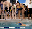 Third Place | Sports Photo Story Mark Dolejs, The Daily DispatchJoining others from the side of the pool, RaShawnna cheers on a teammate during a meet at Aycock Recreation Center.