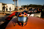 Honorable Sports | Feature Photo Story Andrew Craft, The Fayetteville ObserverA helmet sits atop a car as all the crews gather in the center of the pit area Saturday, March 28, 2015, at Fayetteville Motor Speedway in Fayetteville, N.C.