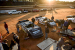 Honorable Sports | Feature Photo Story Andrew Craft, The Fayetteville ObserverCrews work on getting their cars ready for the night's races Saturday, March 28, 2015, at Fayetteville Motor Speedway in Fayetteville, N.C.