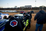 Honorable Sports | Feature Photo Story Andrew Craft, The Fayetteville ObserverGreg Bass Jr. gets out of his car after taking a warmup lap around the track Saturday, March 28, 2015, at Fayetteville Motor Speedway in Fayetteville, N.C.