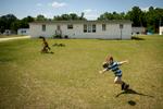 Photographer of the Year Andrew Craft, The Fayetteville ObserverElijah Edwards plays catch with his therapist Kristen Weatherington on Wednesday, May 13, 2015, at his home in Vanceboro, N.C. East Coast Behavioral Health is replicating a Connecticut program that provides in-home therapy to struggling parents and their children.