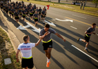 Photographer of the Year Andrew Craft, The Fayetteville ObserverMaj. Gen. Richard D. Clarke, left, gets a high five from a 82nd Airborne Division paratrooper during the division run Monday, May 18, 2015, on Fort Bragg, N.C.