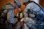 Photographer of the Year Andrew Craft, The Fayetteville ObserverParatroopers with the 2nd  Brigade Combat Team provide medical attention to a local national role player during a joint forcible entry exercise on Thursday, Aug. 6, 2015 at the U.S. Army's National Training Center at Fort Irwin, Ca.